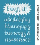 calligraphic brush pen font... | Shutterstock .eps vector #386625535
