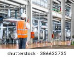 engineer working in a thermal... | Shutterstock . vector #386632735