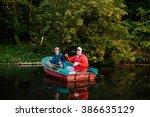 Two Fishermen Fishing In A...