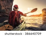 lady paddling the kayak in the... | Shutterstock . vector #386640709