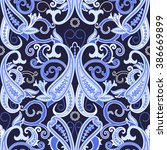 seamless paisley background.... | Shutterstock .eps vector #386669899