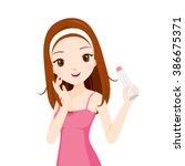 girl holding beauty packaging ... | Shutterstock .eps vector #386675371