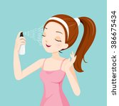 girl spraying mineral water on...   Shutterstock .eps vector #386675434