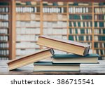 books on the table in the... | Shutterstock . vector #386715541