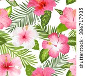 tropical flowers and leaves... | Shutterstock .eps vector #386717935