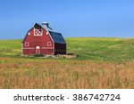 red barn on green field with... | Shutterstock . vector #386742724