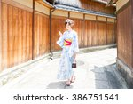 attractive asian woman wearing... | Shutterstock . vector #386751541