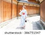 attractive asian woman wearing... | Shutterstock . vector #386751547