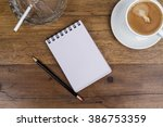 white sheets notebook with... | Shutterstock . vector #386753359