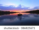 autumn landscape fisherman in... | Shutterstock . vector #386825671