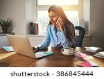 woman working on laptop at... | Shutterstock . vector #386845444