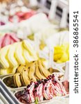 Small photo of classic italian gourmet gelato gelatto ice cream display in shop