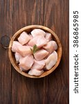 raw chicken meat in bowl over... | Shutterstock . vector #386865985