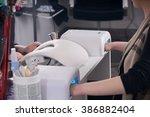 woman in a nail salon receiving ... | Shutterstock . vector #386882404