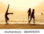 Silhouettes Of Children On The...