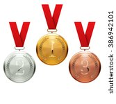 gold  silver and bronze medals | Shutterstock .eps vector #386942101