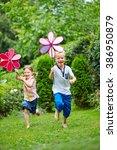 Two Happy Children Running Wit...