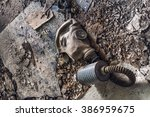 old dirty gas mask lying on... | Shutterstock . vector #386959675