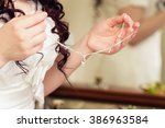 bride holds in hand a... | Shutterstock . vector #386963584