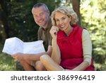 a mature couple sitting...   Shutterstock . vector #386996419