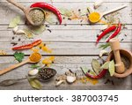 colorful spices on a wooden... | Shutterstock . vector #387003745