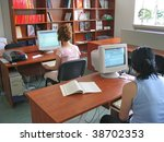 two girls working on the... | Shutterstock . vector #38702353