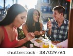 happy couple sharing french fry ...   Shutterstock . vector #387029761