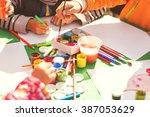 children draw with parents... | Shutterstock . vector #387053629