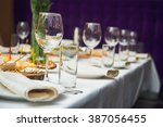 glasses on restaurant. table... | Shutterstock . vector #387056455