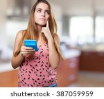 pensive young woman holding a... | Shutterstock . vector #387059959
