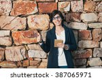 young successful smiling woman... | Shutterstock . vector #387065971