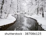 winter landscape with a lake in ... | Shutterstock . vector #387086125