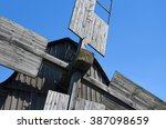 blue windmill sky. old wooden... | Shutterstock . vector #387098659