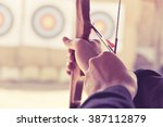 image of archer holds his bow... | Shutterstock . vector #387112879