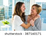mother and daughter smiling at... | Shutterstock . vector #387160171