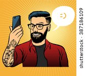 hipster with tattoos makes... | Shutterstock .eps vector #387186109