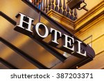 a luxury hotel entrance with... | Shutterstock . vector #387203371