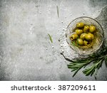 Olives With Rosemary On A Ston...