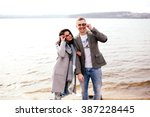 the boy closes eyes girl by sea ... | Shutterstock . vector #387228445