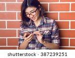 beautiful young woman standing... | Shutterstock . vector #387239251