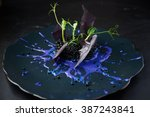 plate with black risotto on... | Shutterstock . vector #387243841