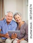 portrait of senior couple... | Shutterstock . vector #387245374