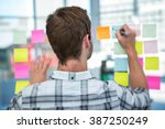 hipster man writing on post it... | Shutterstock . vector #387250249