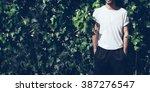 bearded man with tattoo wearing ... | Shutterstock . vector #387276547