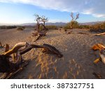 sand dunes and mountains in... | Shutterstock . vector #387327751