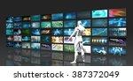 man looking into video wall... | Shutterstock . vector #387372049
