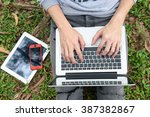 young man with phone and laptop ... | Shutterstock . vector #387382867