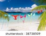 Stock photo rainbow colored bikinis hanging on tropical beach 38738509