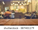 empty brown wooden table and... | Shutterstock . vector #387401179