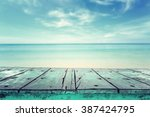 empty top of wooden table and... | Shutterstock . vector #387424795
